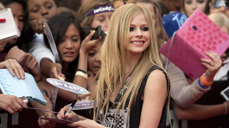 Canadian singer Avril Lavigne arrives on the red carpet during the 2011 MuchMusic Video Awards in Toronto on Sunday, June 19, 2011. (Chris Young / THE CANADIAN PRESS)