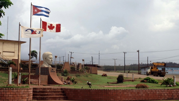Canadian flag flies alongside the Cuban flag