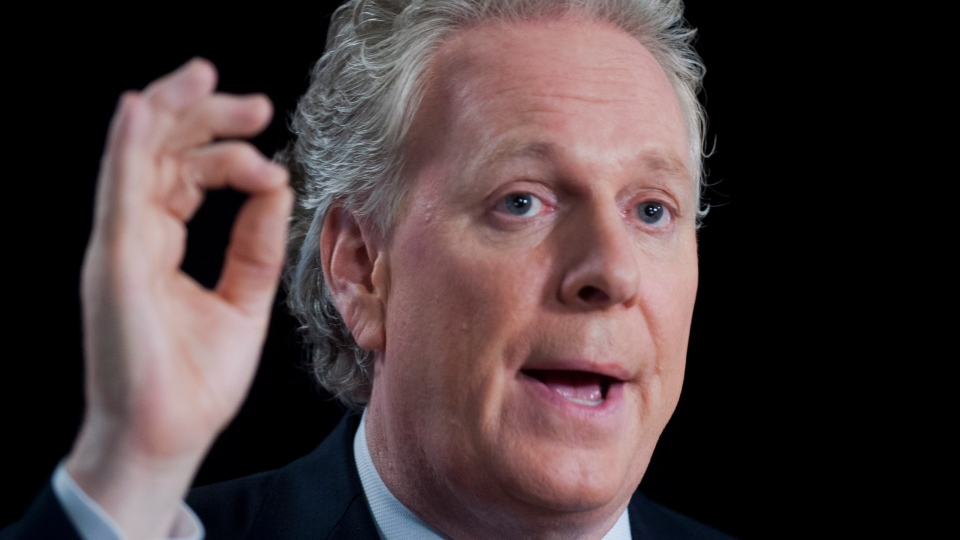 Quebec Premier Jean Charest speaks to reporters following a leaders debate in Montreal, Tuesday, August 21, 2012. (Graham Hughes/THE CANADIAN PRESS)