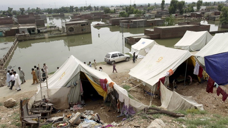 People live in tents as their houses are submerged in floodwaters in Nowshera Pakistan on & Pakistani Taliban hint at attacks on relief workers | CTV News