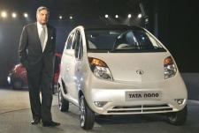 Tata Company Chairman Ratan Tata with his Tata Nano at the 9th Auto Expo in New Delhi, India, Thursday, Jan. 10, 2008. (AP Photo / Saurabh Das)