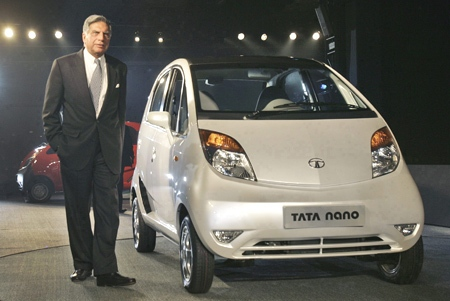 Tata Company Chairman Ratan Tata with his Tata Nano at the 9th Auto Expo in New Delhi, India, Thursday, Jan. 10, 2008. (AP Photo / Saurabh Das)