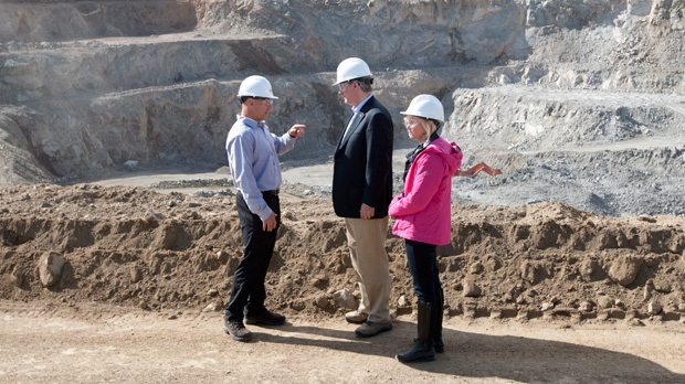 FILE - Prime Minister Stephen Harper and his wife Laureen talk with Capstone Mining CEO Darren Pylot in front of the Minto mine in Minto, Yukon, Tuesday, Aug. 21, 2012. (Adrian Wyld / THE CANADIAN PRESS)