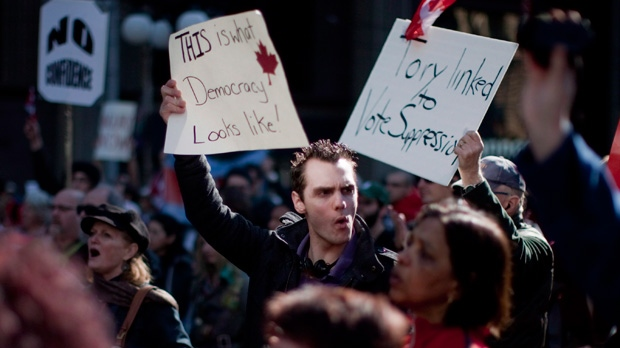 Protesters listen to a speaker at a demonstration in Toronto on Sunday March 11, 2012, part of a nationwide protest in response to the widening 'Robocall' election fraud scandal. (Chris Young / THE CANADIAN PRESS)