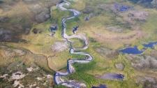 A river runs through a valley near Moose Ponds, NWT