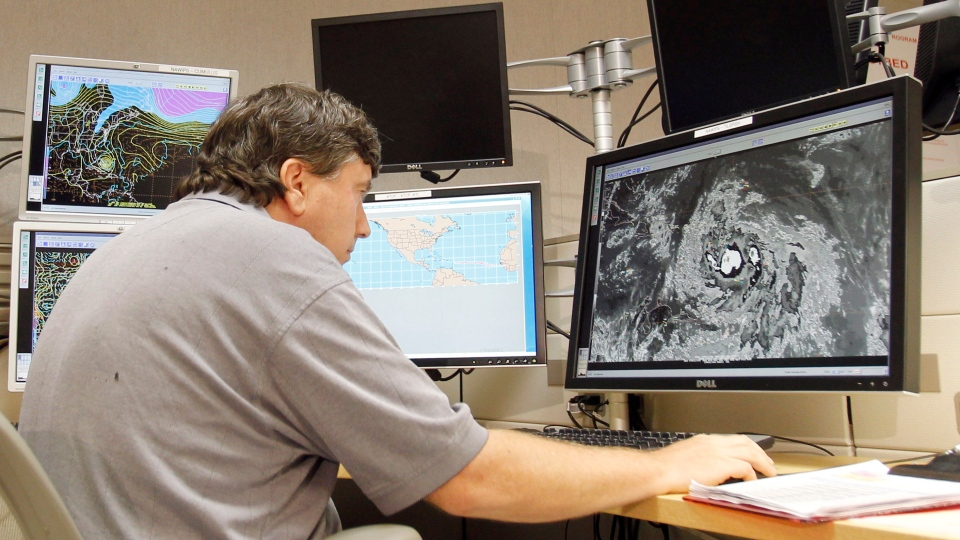 Jack Beven, senior hurricane specialist, tracks Tropical Storm Isaac Wednesday, Aug. 22, 2012, at the National Hurricane Center in Miami. (AP/Alan Diaz)