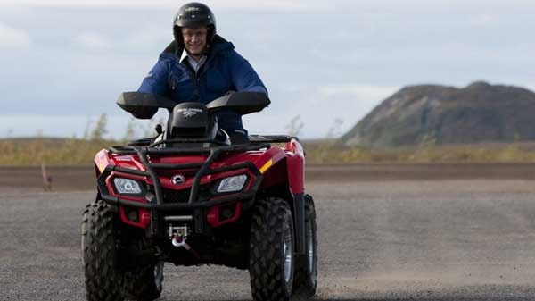 Prime Minister Stephen Harper drives an ATV as he visits Tuktoyaktuk, Northwest Territories on the fourth day of his five day northern tour to Canada's Arctic on Thursday Aug. 26, 2010. (Sean Kilpatrick / THE CANADIAN PRESS)