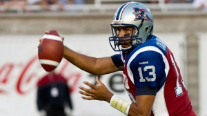 Montreal Alouettes quarterback Anthony Calvillo looks for a receiver during first quarter CFL football action against the Calgary Stampeders in Montreal on Thursday, July 12, 2012. (The Canadian Press/Paul Chiasson)