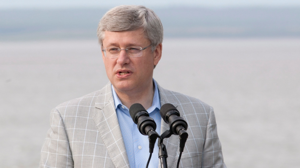 Prime Minister Stephen Harper announces the Nv Naats'ihch'oh National Park Reserve during an event on the shores of the Mackenzie River in Norman Wells, N.W.T., Wednesday, Aug. 22, 2012. (Adrian Wyld / THE CANADIAN PRESS)
