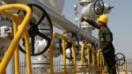 Iranian oil technician Majid Afshari checks the oil separator facilities in Azadegan oil field, near Ahvaz, Iran, Tuesday, April 15, 2008. (AP / Vahid Salemi)