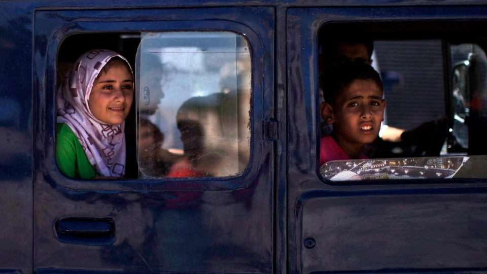 Syrian children look out from the windows of a vehicle in the city of Azaz, on the outskirts of Aleppo, Syria, Wednesday, Aug. 22, 2012. (AP / Muhammed Muheisen)