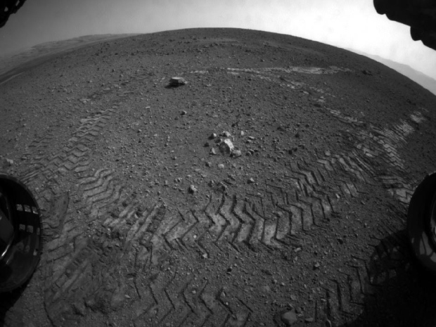 This image shows the tracks left by NASA's Curiosity rover as it completed its first test drive