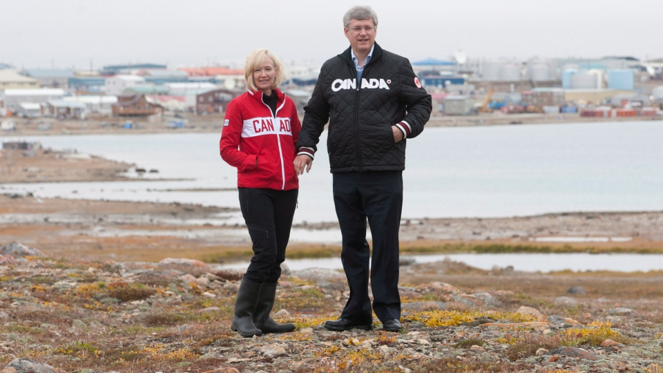 Prime Minister Stephen Harper and his wife Laureen stand overlooking Cambridge Bay, Nunavut, Thursday, Aug. 23, 2012. (Adrian Wyld  / THE CANADIAN PRESS)