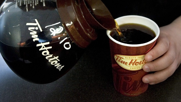 A cup of Tim Hortons coffee is poured in Toronto on Friday, May 14, 2010. (Chris Young / THE CANADIAN PRESS)