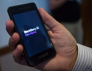 An attendee at the Blackberry 10 Jam World Tour holds one of the company's DevAlpha devices at their stop in Waterloo, Ont., Thursday, Aug. 23, 2012. (Geoff Robins / THE CANADIAN PRESS)