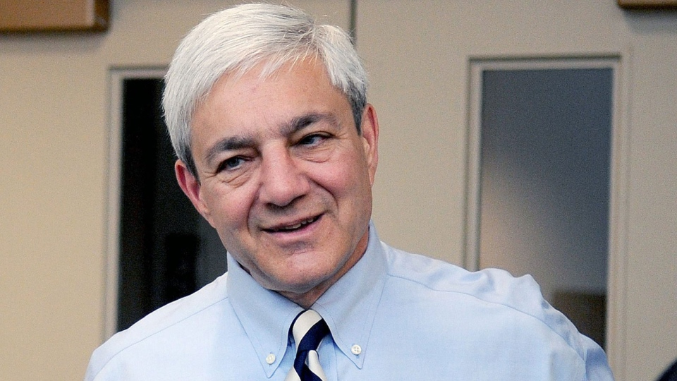 Penn State President Graham Spanier arrives at the University Park Airport in State College, Pa., July 12, 2012. (AP / Centre Daily Times, Abby Drey)
