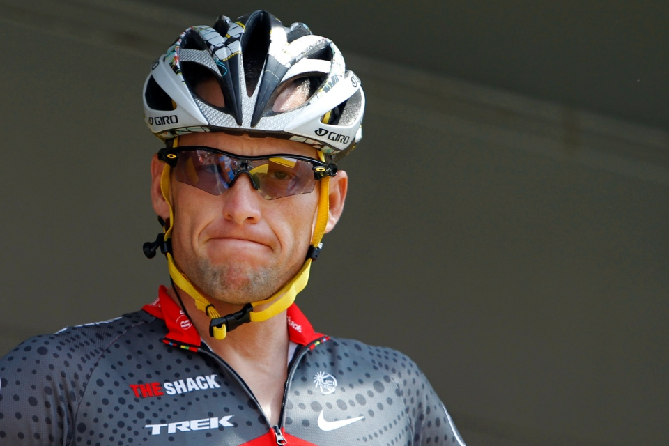 Lance Armstrong grimaces prior to the start of the third stage of the Tour de France cycling race in Wanze, Belgium, July 6, 2010. (AP / Christophe Ena)
