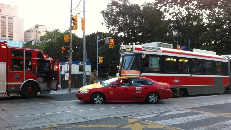 A crash involving two taxis and a streetcar delayed morning traffic on Friday, Aug. 24, 2012. (Tom Stefanac / CTV Toronto)