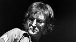 John Lennon performs during a charity concert to benefit mentally challenged children at New York's Madison Square Garden, in this file photo from Aug. 30, 1972. (AP Photo-File)