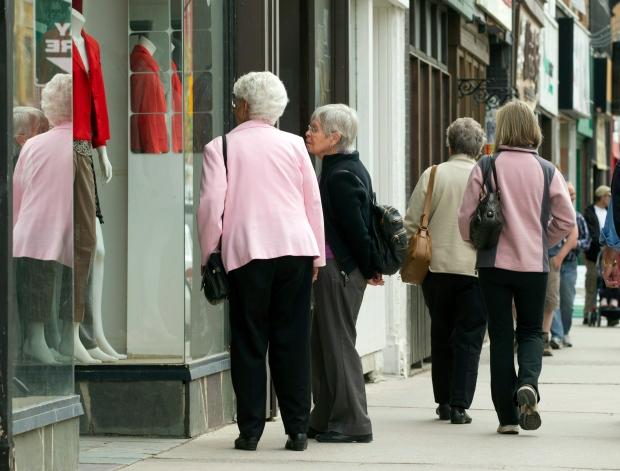 Senior citizens window shop