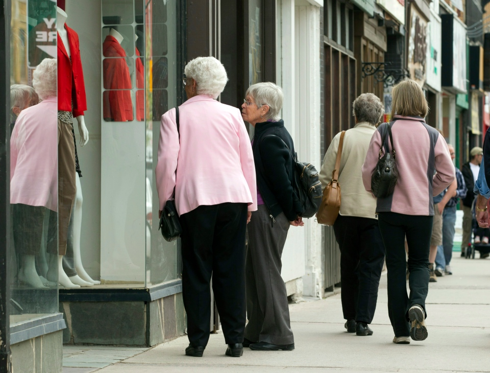 Senior citizens window shop as they make their way down the a main street in Peterborough, Ont. on Monday, May 7, 2012. (Frank Gunn / THE CANADIAN PRESS)