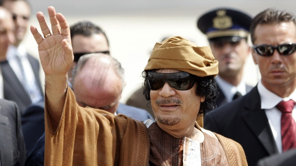 Libyan leader Moammar Gadhafi gestures as he arrives at Ciampino airport, near Rome, Sunday Aug. 29, 2010. Gadhafi is in Rome for his fourth visit in a year. (AP photo/Riccardo De Luca)