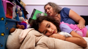 Ariana Birnbaum reads to put her five-year-old daughter Noa Brown to bed in Toronto on Wednesday, July 25, 2012. Birnbaum is firm on getting her children back into routines before school begins. THE CANADIAN PRESS/Michelle Siu.