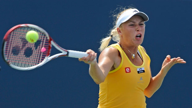Caroline Wozniacki, of Denmark, hits a forehand during her semifinal match with Maria Kirilenko, of Russia, at the New Haven Open tennis tournament in New Haven, Conn., on Friday, Aug. 24, 2012. (AP / Fred Beckham)