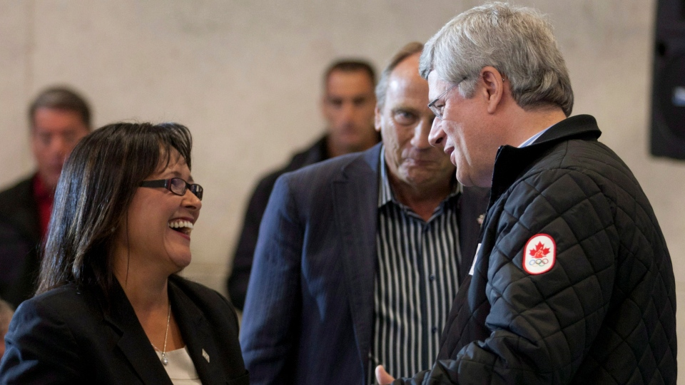 Prime Minister Stephen Harper talks with Minister of Health Leona Aglukkaq after announcing she will be the next Chair of the Arctic Council in Cambridge Bay, Nunavut, Thursday, Aug. 23, 2012. (Adrian Wyld / THE CANADIAN PRESS)