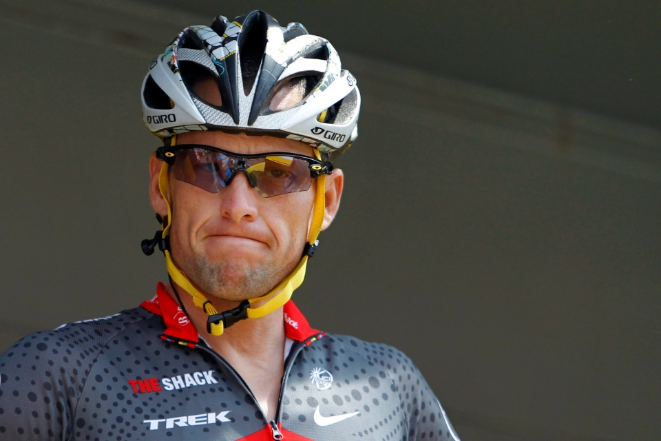 Lance Armstrong grimaces prior to the start of the third stage of the Tour de France cycling race in Wanze, Belgium, Tuesday, July 6, 2010. (AP / Christophe Ena)