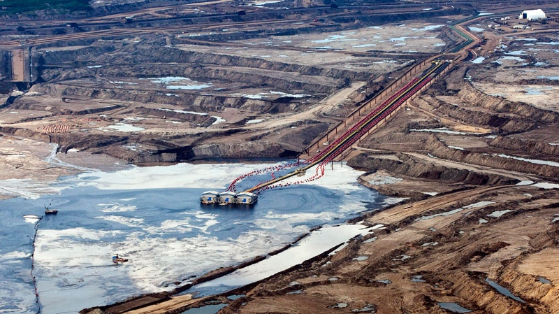 Waste water that spilled at an oilsands plant in northern Alberta has been released into a nearby river. (Jeff McIntosh / THE CANADIAN PRESS)