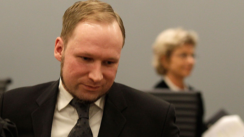 Anders Behring Breivik leaves the courtroom after the trial while judge Wenche Elisabeth Arntzen passes in background in Oslo, Norway, Friday, Aug. 24, 2012. (AP / Frank Augstein)
