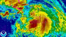 Tropical Storm Isaac is shown churning through Haiti in this enhanced NOAA satellite image