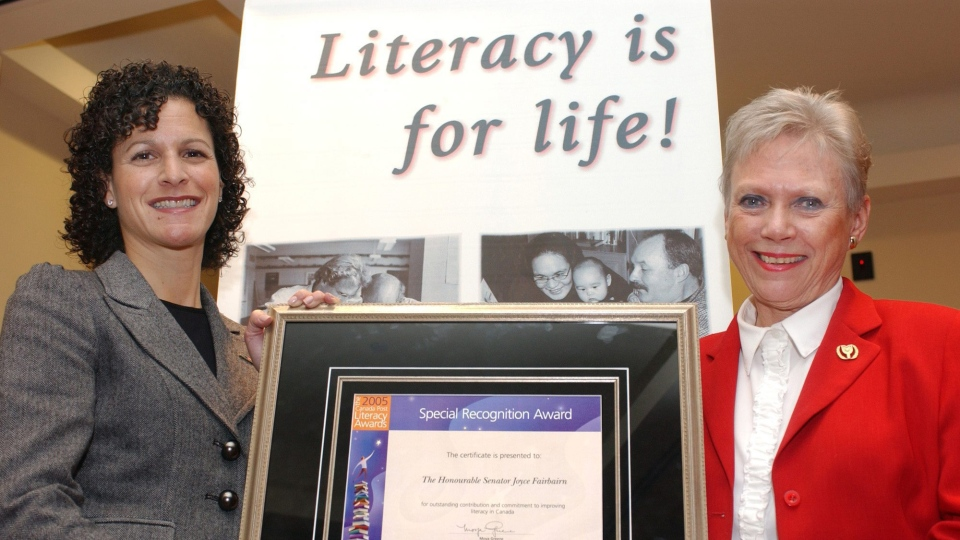 On Literacy Action Day, Senator Joyce Fairbairn was presented with the first-ever Canada Post Special Recognition Literacy Award, in appreciation of the Senator's commitment and dedication to literacy. Shown is the Honourable Joyce Fairbairn receiving her award from Canada Post's vice-president of Government Relations and Policy Framework, Susan Margles. (CCN PHOTO/CANADA POST)