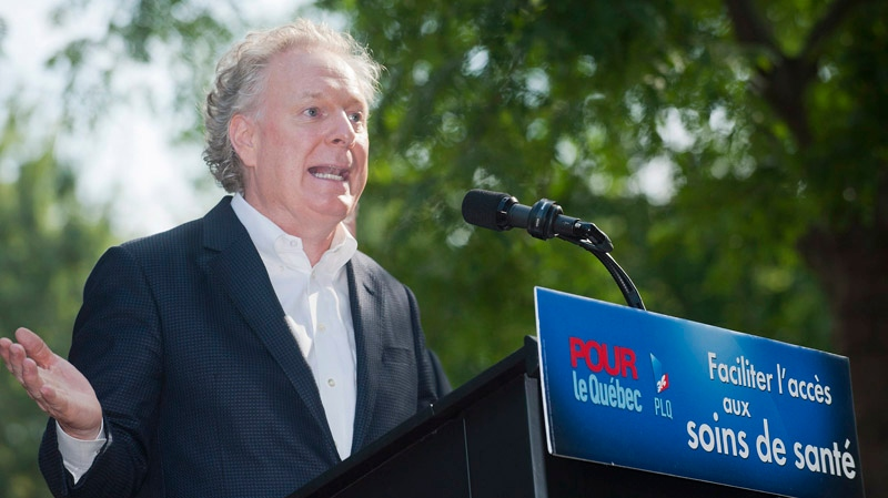 Quebec Premier Jean Charest speaks to reporters during an election campaign stop in Saint-Bruno, Que., Saturday, August 25, 2012. THE CANADIAN PRESS/Graham Hughes