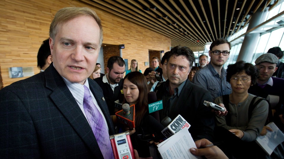 Peter Julian, NDP MP for Burnaby-New Westminster, speaks to reporters during a news conference in Vancouver, B.C., on Tuesday, June 26, 2012. (Darryl Dyck / THE CANADIAN PRESS)