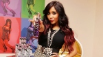 In this Nov. 3, 2011 file photo, TV personality Nicole 'Snooki' Polizzi poses at the launch of her new fragrance Snooki by Nicole Polizzi in New York. (AP Photo/Starpix, Amanda Schwab, file)