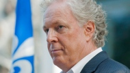 Former Quebec Premier Jean Charest speaks to reporters during an election campaign stop in Saint-Bruno, Que., Saturday, Aug. 25, 2012. (Graham Hughes / THE CANADIAN PRESS)