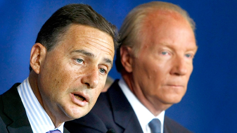 French Immigration Minister, Eric Besson, left with Interior Minister Brice Hortefeux reacts during an press-conference in Paris, Monday Aug. 30, 2010. (AP / Jacques Brinon)