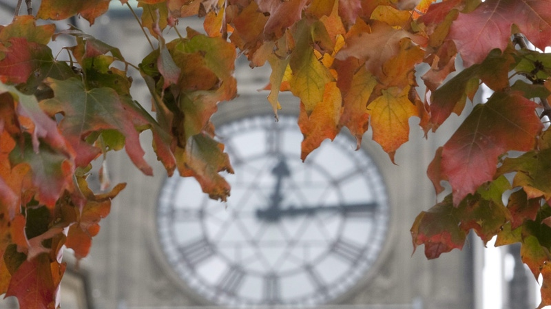 Changing autumn leaves frame the clock on the Peace Tower on Parliament Hill in Ottawa, September 24, 2010. (Adrian Wyld / THE CANADIAN PRESS)