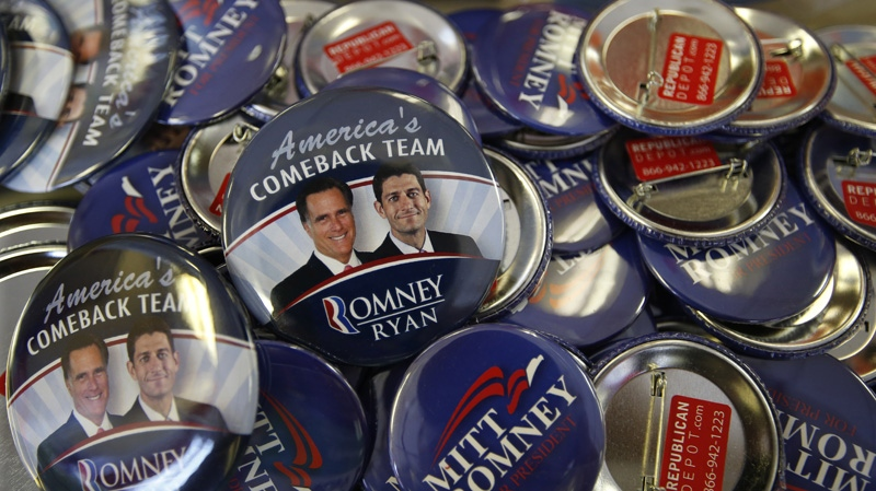 Republican presidential candidate and former Massachusetts Gov. Mitt Romney along with his running mate Republican vice presidential candidate, Rep. Paul Ryan, R-Wis., campaign buttons are displayed ahead of the Republican National Convention in Tampa, Fla., on Sunday, Aug. 26, 2012. (AP Photo/Jae C. Hong)