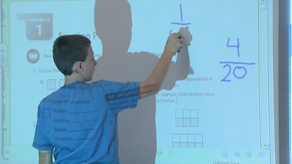 A student works on fractions during a math lesson at his Toronto school in this file photo.