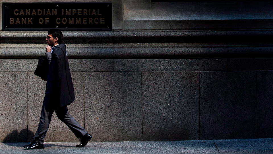 A person walks by the Canadian Imperial Bank of Commerce in Toronto on Thursday, Aug. 23, 2012. (Michelle Siu / The Canadian Press)