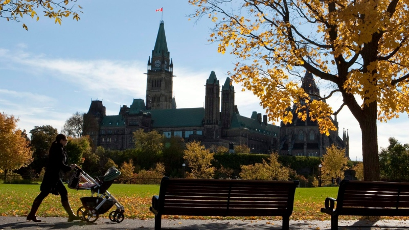 A woman walks with a stroller at Major's Hill Park in Ottawa on Monday, Oct 11, 2010. (Pawel Dwulit / THE CANADIAN PRESS)