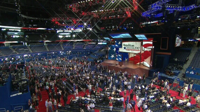 Participants sit among empty seats at the Republican National Convention in this image from video in Tampa, Fla., on Monday, Aug. 27, 2012.