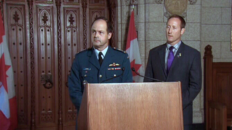 Lt.-Gen. Thomas Lawson and Defence Minister Peter MacKay appear at a press conference in Ottawa in this photo from video, Monday, Aug. 27, 2012.