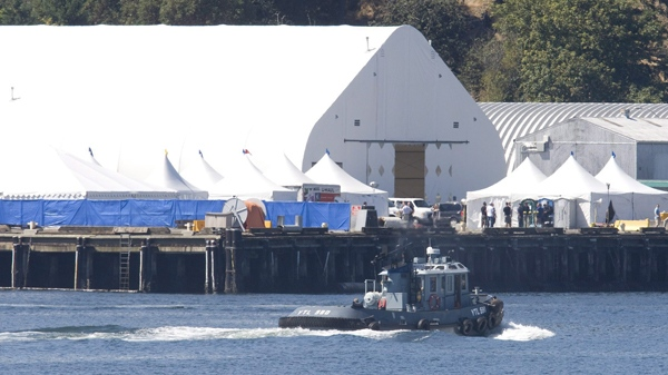 A military boat passes by CFB Esquimalt in Colwood, B.C., near Victoria on Thursday, Aug. 12, 2010. (Jonathan Hayward / THE CANADIAN PRESS)