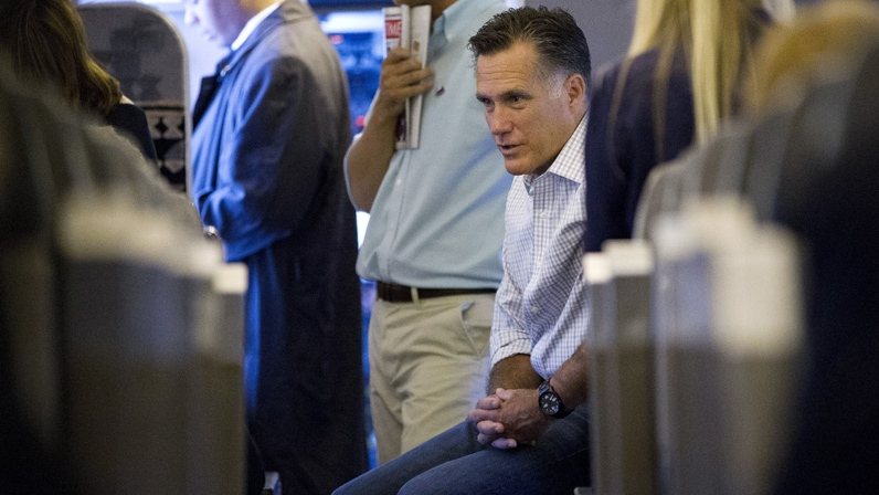 Republican presidential candidate, former Massachusetts Gov. Mitt Romney talks with staff after boarding his flight for Tampa on Tuesday, Aug. 28, 2012 in Bedford, Mass. (AP / Evan Vucci)