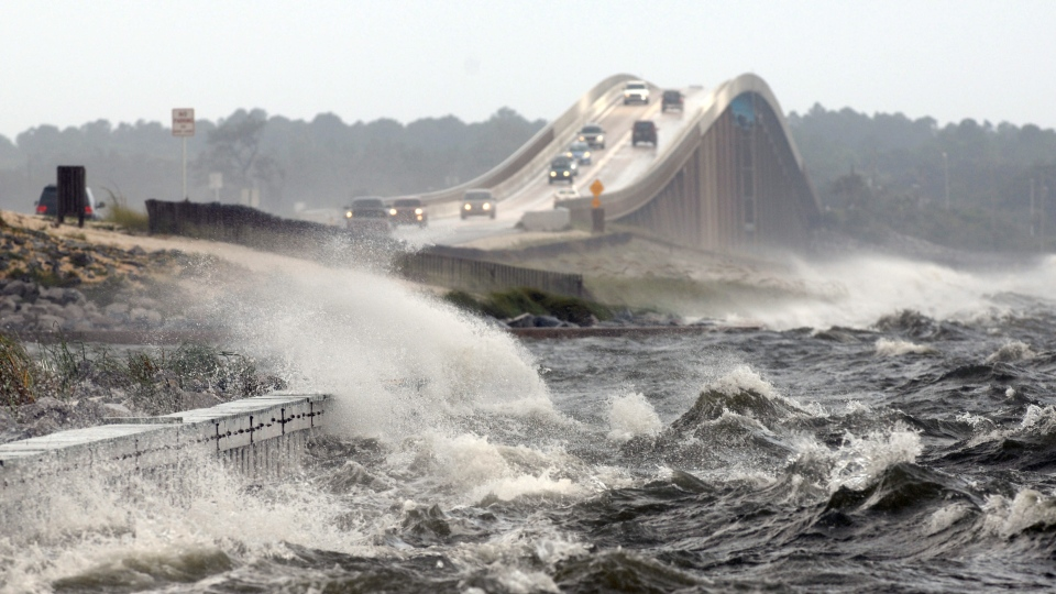 Waves from the Santa Rosa Sound crash over the Navarre Beach causeway in Navarre, Fla., as Hurricane Isaac approaches the Gulf Coast on Tuesday, Aug. 28, 2012. (Northwest Florida Daily News / Nick Tomecek)