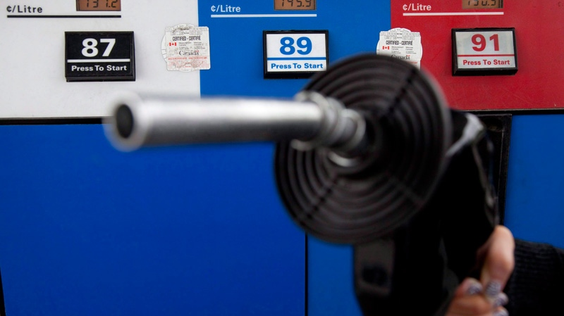 Gas prices are displayed as a motorist prepares to pump gas at a station in North Vancouver, B.C. Tuesday, May 10, 2011. (Jonathan Hayward / THE CANADIAN PRESS)